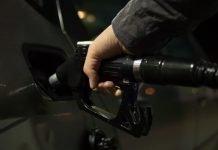 Person Holding Gasoline Nozzle - Skitterphoto