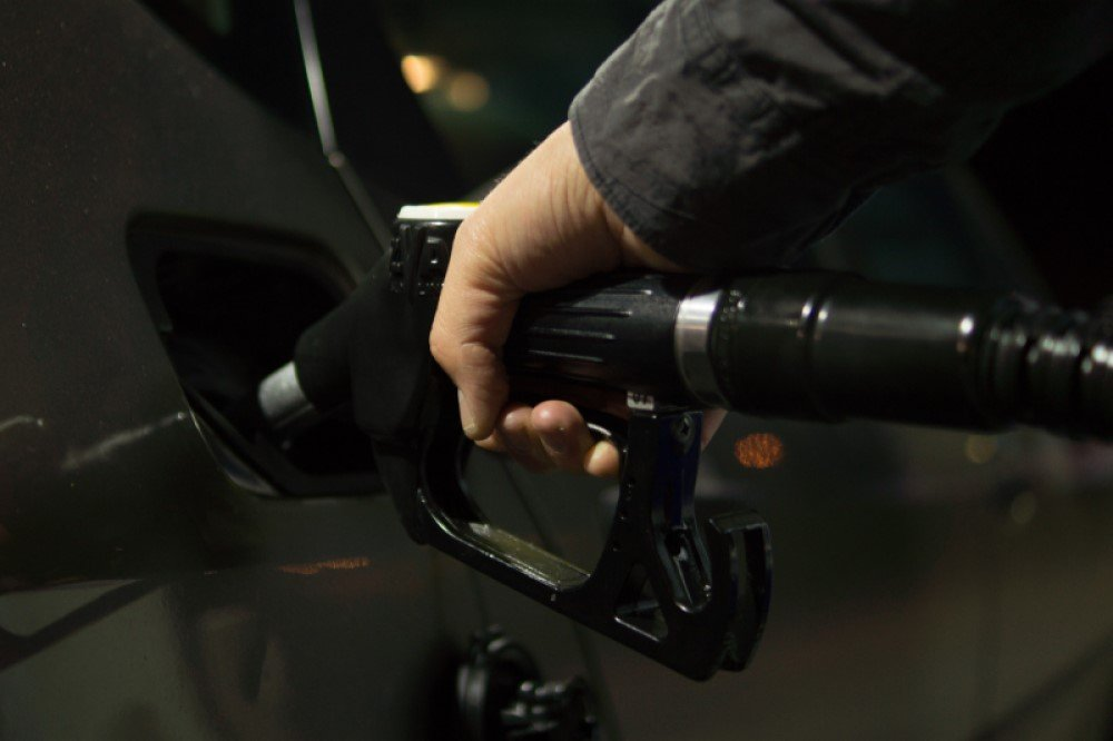 Person Holding Gasoline Nozzle - Skitterphoto