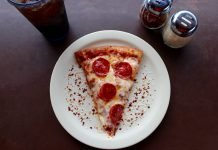 Sliced Pepperoni Pizza on White Ceramic Plate - Sydney Troxell