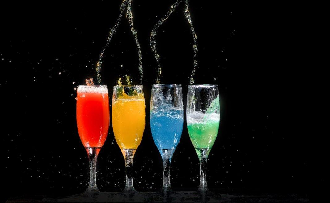 Four Champagne Flutes With Assorted-Color Liquids - George Desipris via Pexels