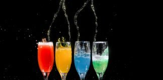 Four Champagne Flutes With Assorted-Color Liquids - George Desipris via Pexels